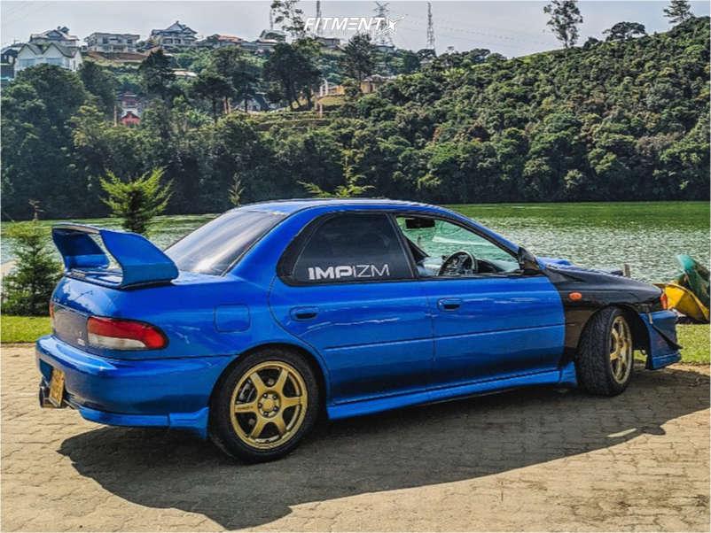 Blue 1999 Subaru WRX STI base with Speedline Corse 2108 wheels, Nankang NA-II tires, and Gecko Racing coilovers