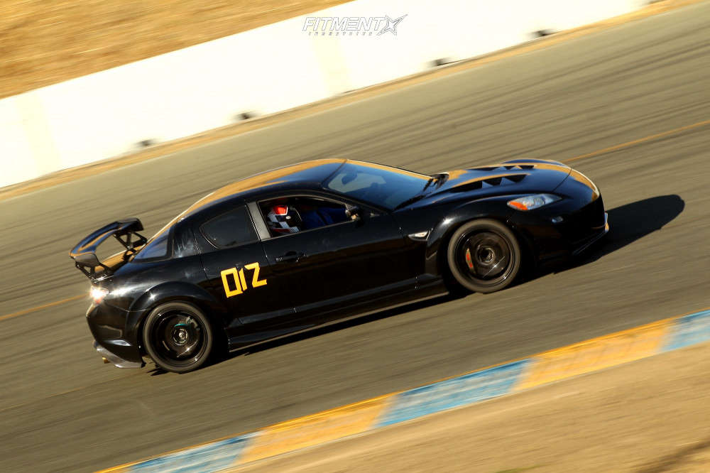 Racing shot of 2009 MAZDA RX-8 R3 running Advan Racing Rs-df Progressive wheels, Toyo Tires Proxes R888r , and Ohlins Coilovers