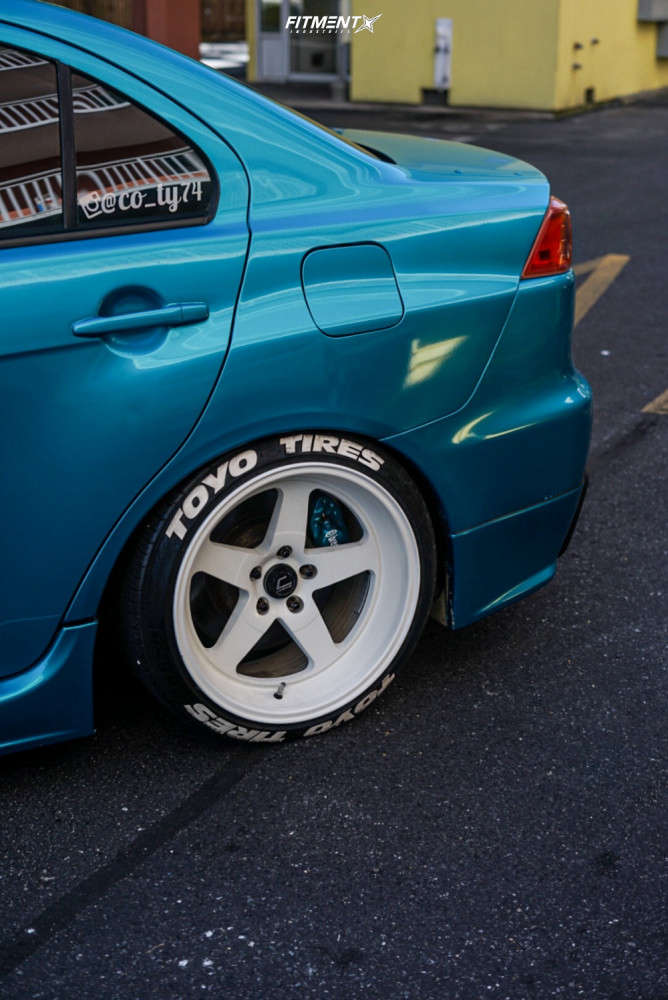 2008 MITSUBISHI LANCER EVOLUTION GSR running Cosmis Racing Xt-005r, Toyo Tires Proxes 4 Plus, and BC Racing Coilovers