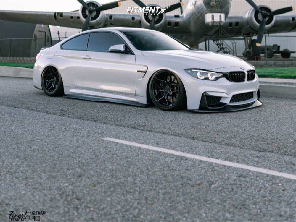 Front shot of a 2016 BMW M4 BASE with Rohana Rfx11, Michelin Pilot Sport Ps2, and Air Lift Performance Air Suspension