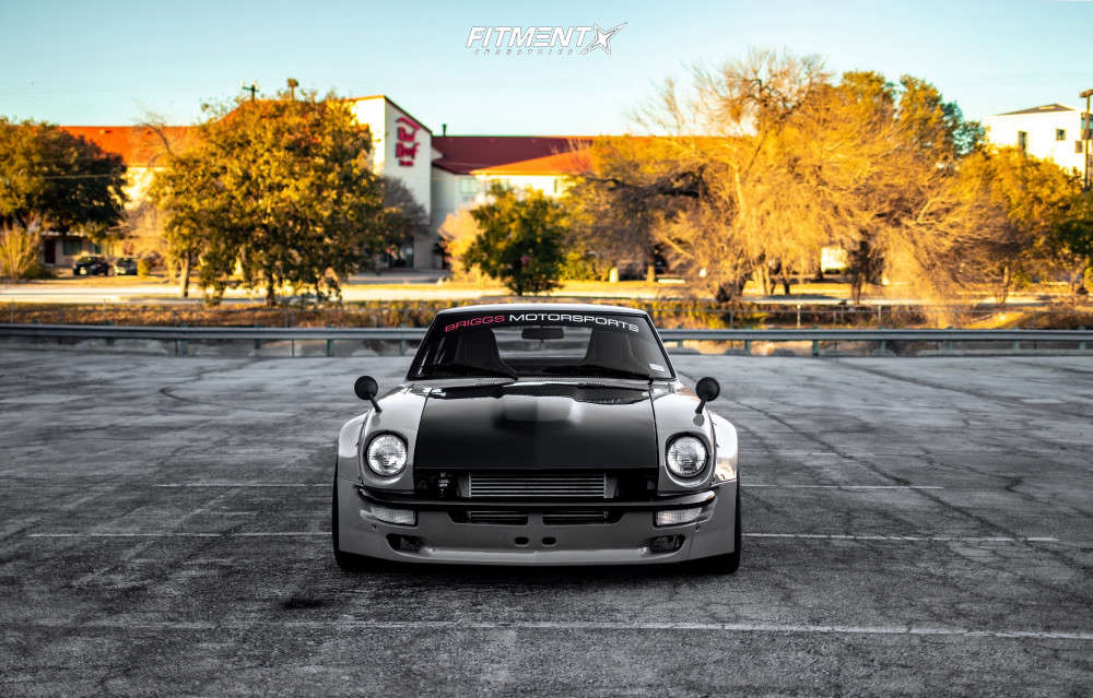 A grey 1973 Nissan 240Z running American Racing VF502 wheels, Nitto Invo tires, and coilovers