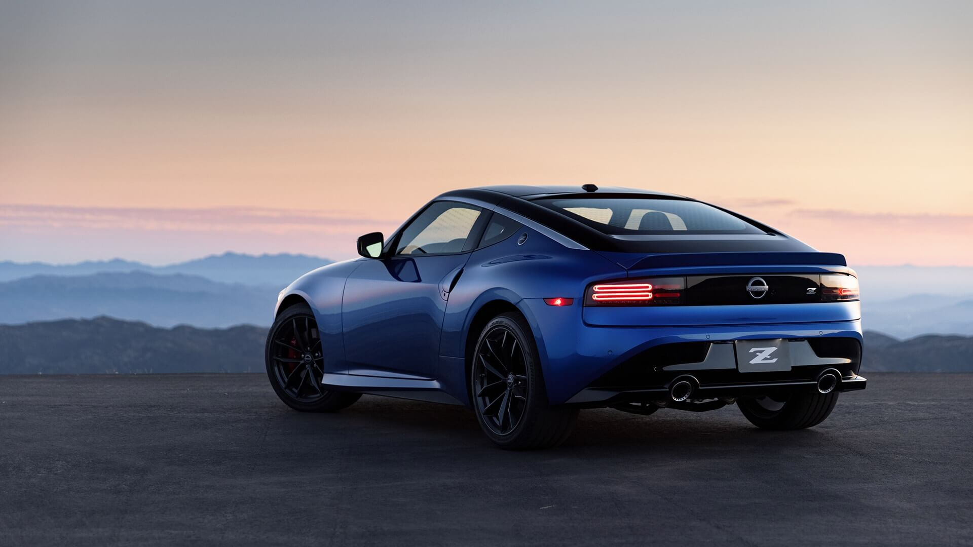 The all new 2023 Nissan 400 z with a sunset peaking through in the background