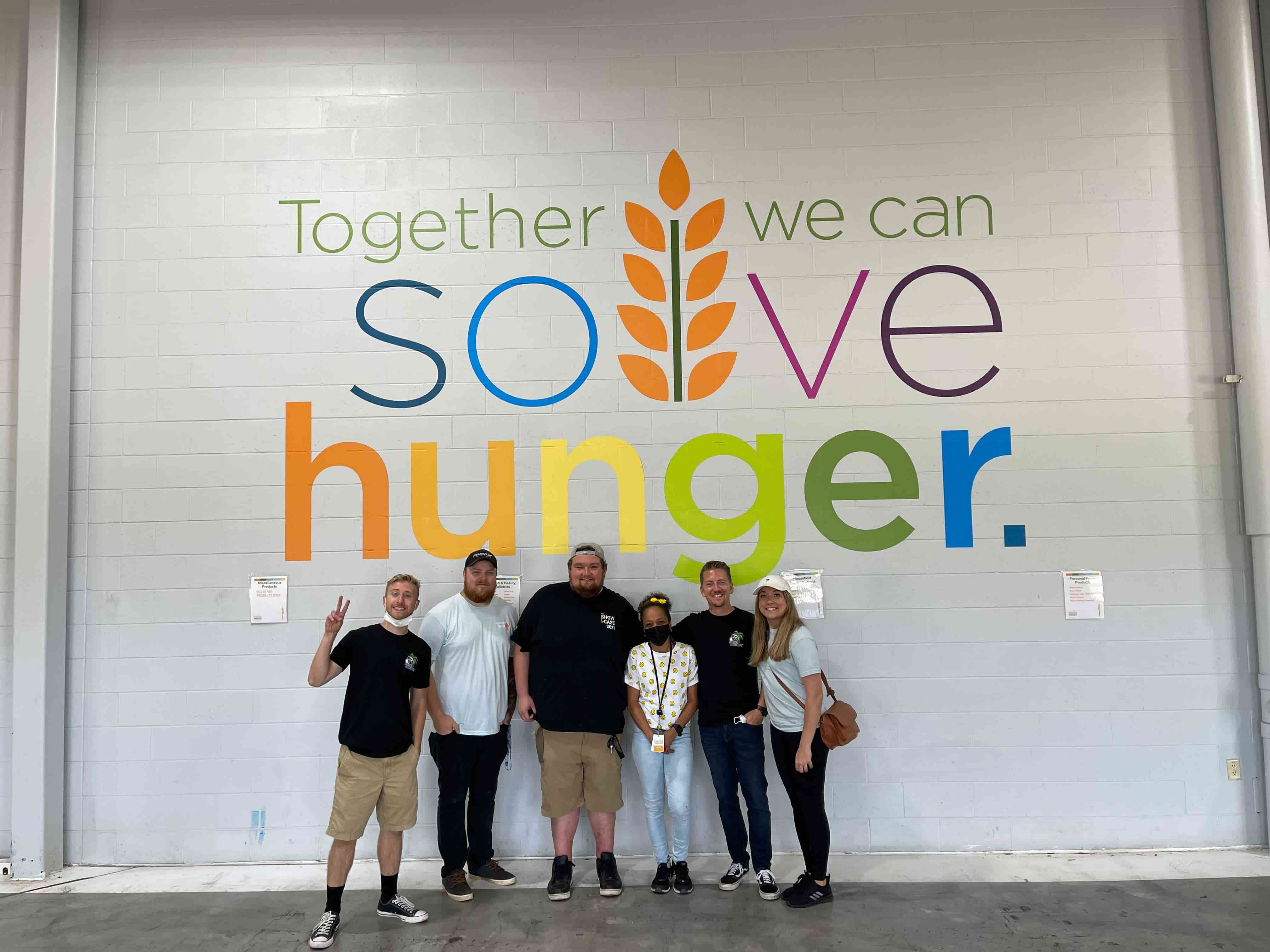 The Fitment Industries crew at Feeding America donating their time to help those in need!