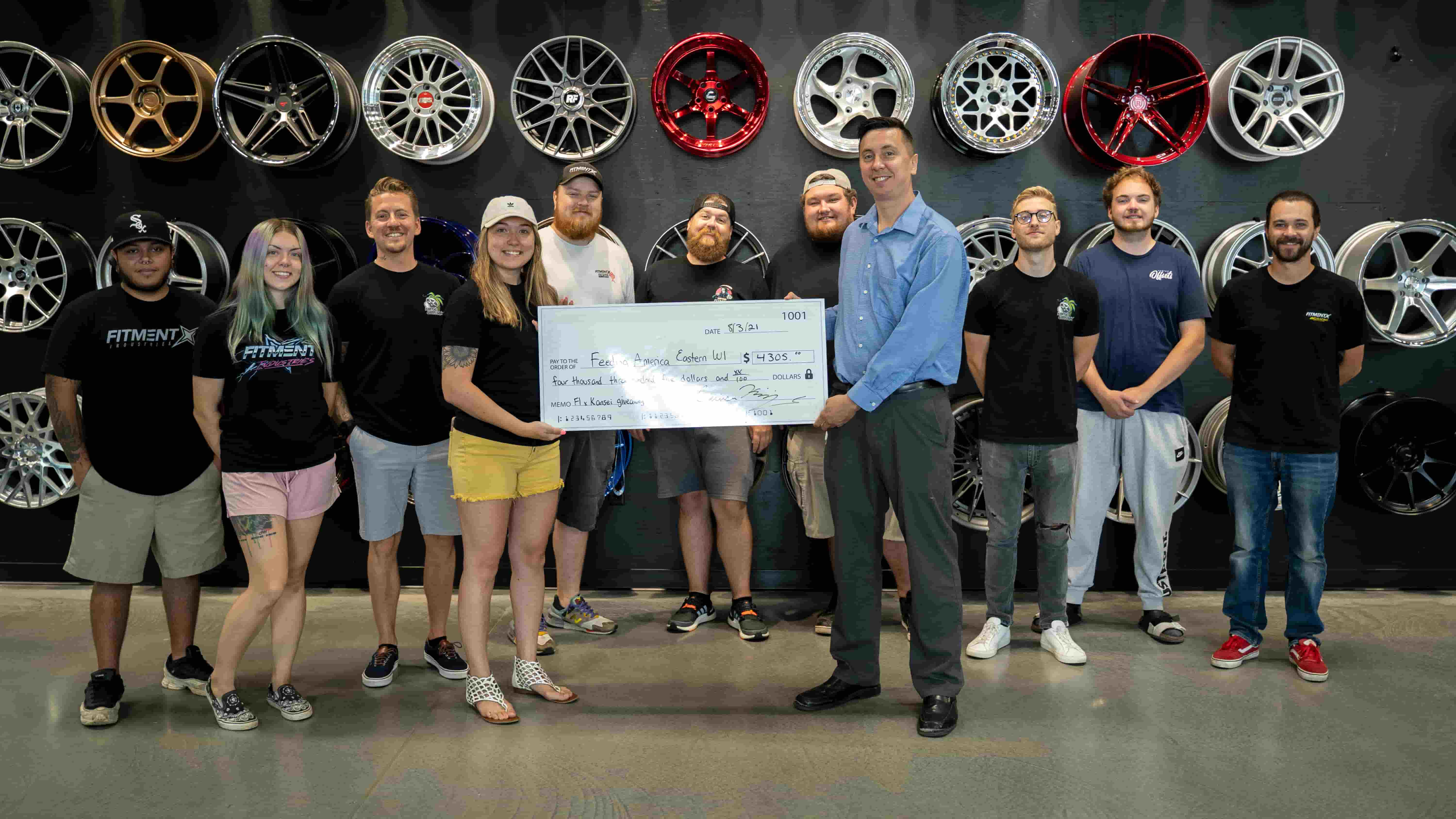Group picture with the Fitment Industries' team at Feeding America with our $4,305 donation!