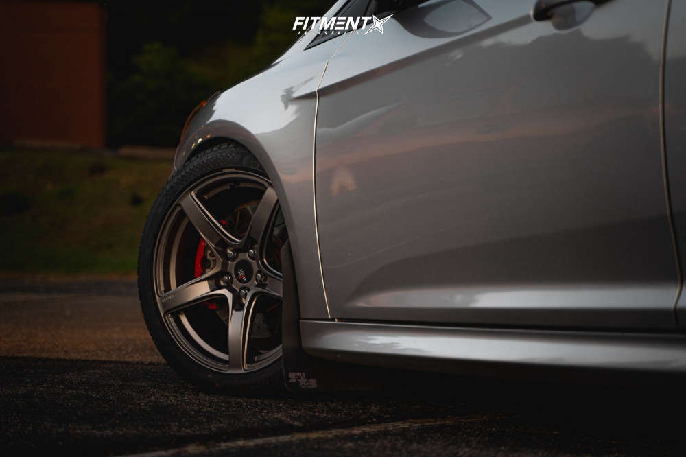 A close up of a 2014 Ford Focus ST running Option Lab R555 wheels, Nankang NS-25 tires, and coilovers