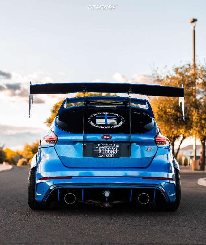 Booty shot of a blue 2017 Ford Focus running The Artisa Elder