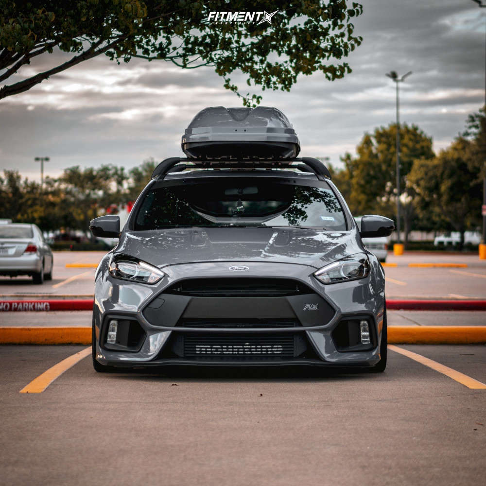 A grey stanced Ford Focus RS running Rotiform CVV wheels and Micheline Pilot Sport Cup 2 tires!