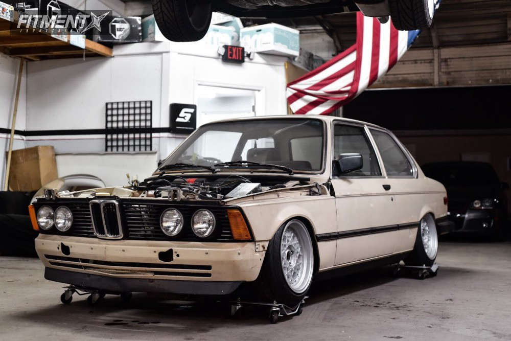 White project car 1980 BMW 320I in a garage
