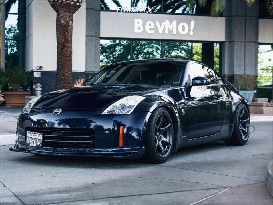 Blue 2008 Nissan 350z Touring with Kansei Tandem wheels, Hankook tires, and Eibach lowering springs
