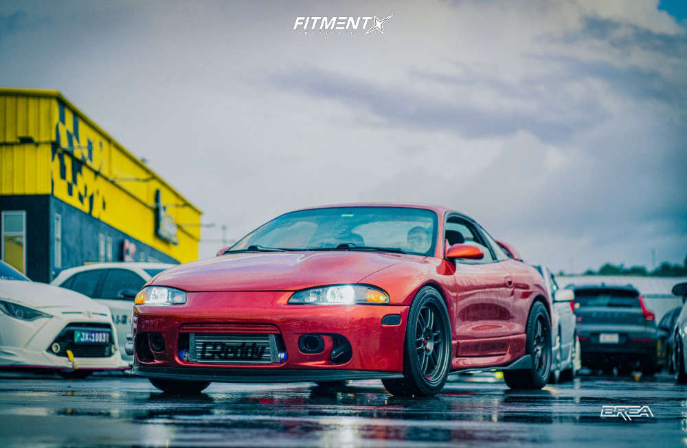 Red -orange 1995 Mitsubishi Eclipse RS with MST Suzuka wheels, Kumho N5000 tires, and coilovers