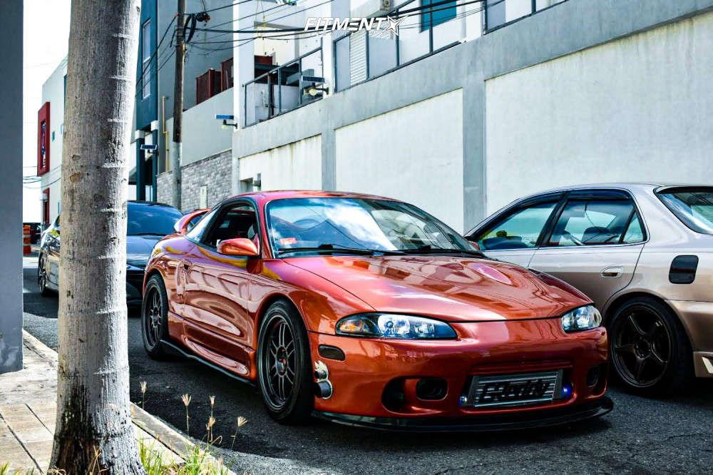 Red-orange 1995 Mitsubishi Eclipse RS witih MST Suzuka wheels, Kumho N500 tires, and Coilovers