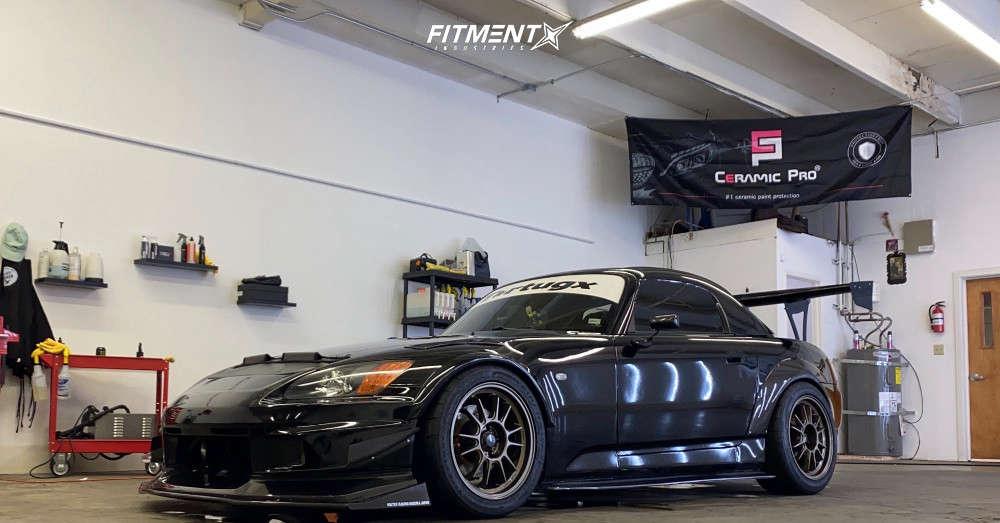 Black 2002 Honda S2000 base with Konig Hypergram, Firestone Firehawk Indy 500, Tein coilovers