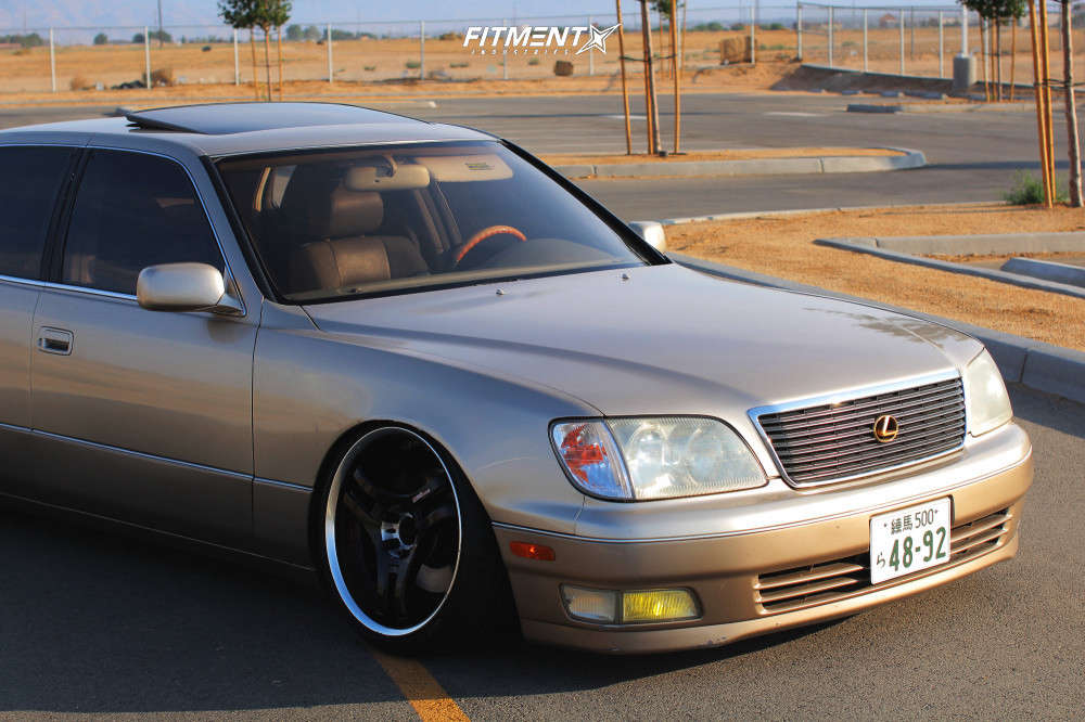 Up close and personal with a 2000 Lexus LS400 Base with Racing Hart S3 Pro wheels, Accelera Phi tires, and Megan Racing coilovers