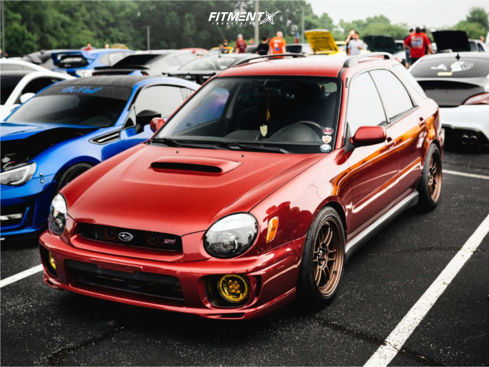 Red 2002 Subaru WRX WRX with Enkei Rpt1 wheels, Firestone Indy 500 tires, and BC Racing coilovers
