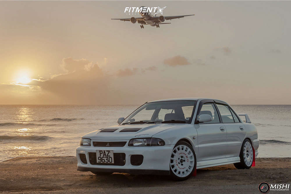 1995 Mitsubishi Mirage ES running OZ Rally Racing wheels, Sailun Atrezzo ZSR tires, and Fortune Auto Coilovers