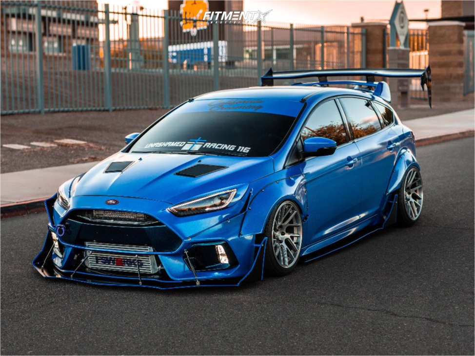 A wide-bodied 2017 Ford Focus ST running The Artisa Elder 18x9.5 +22 with Accelera 651 Sport tires, and Air Lift Air Suspension