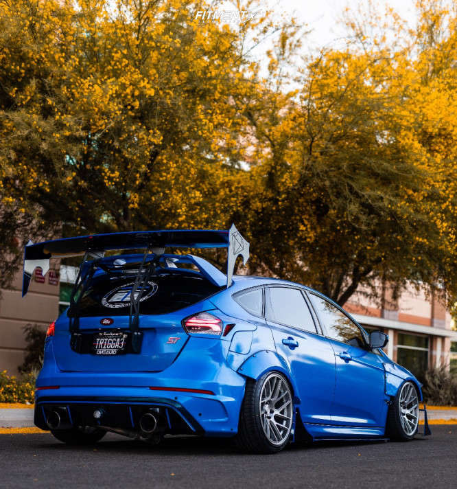 Rear shot of a  wide-bodied 2017 Ford Focus ST running The Artisa Elder 18x9.5 +22 with Accelera 651 Sport tires, and Air Lift Air Suspension