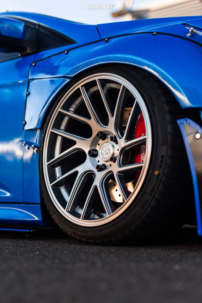 Up close and personal with a wide-bodied 2017 Ford Focus ST running The Artisa Elder 18x9.5 +22 with Accelera 651 Sport tires, and Air Lift Air Suspension