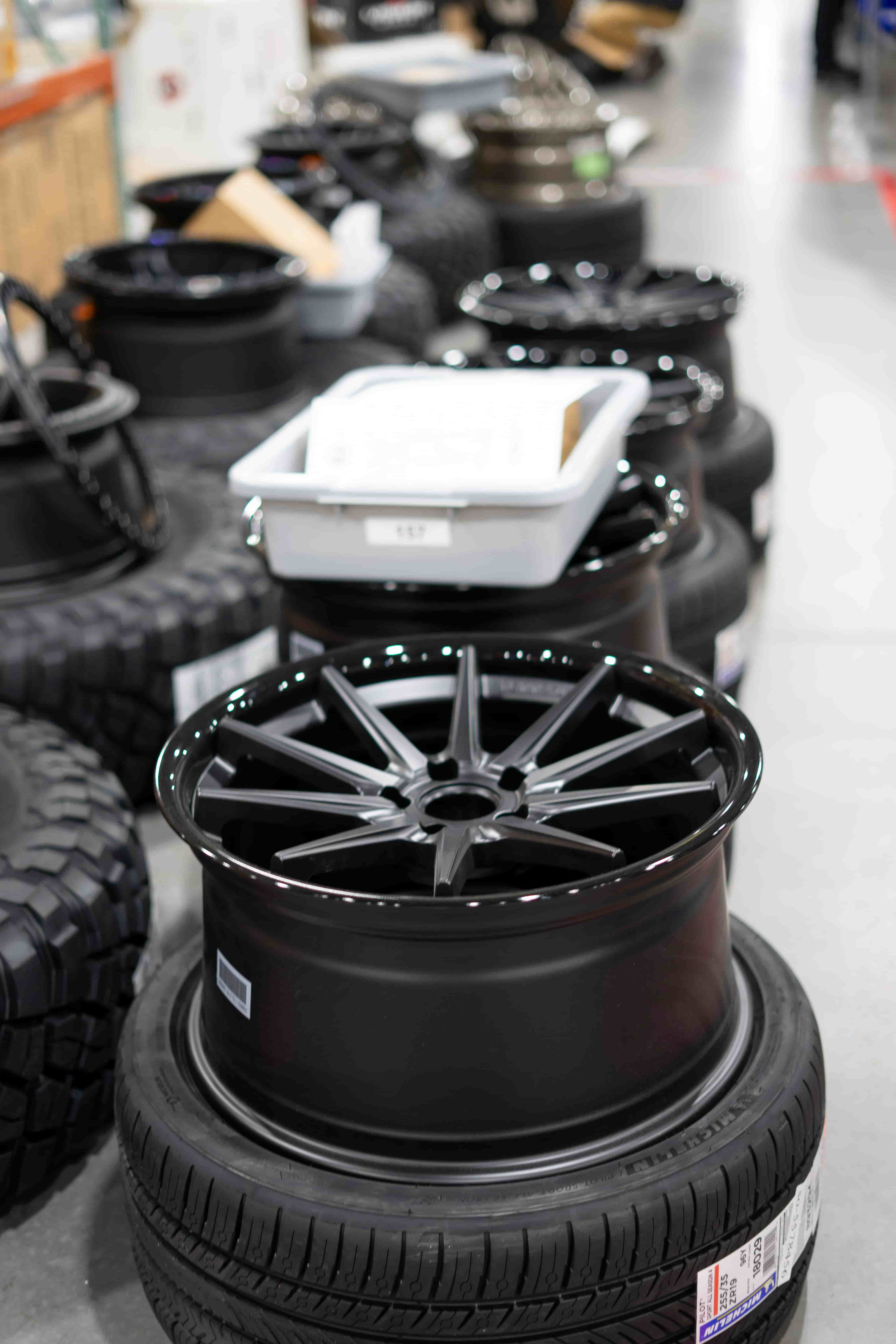 Fitment Industries' warehouse with wheels, tires, and suspension ready to ship