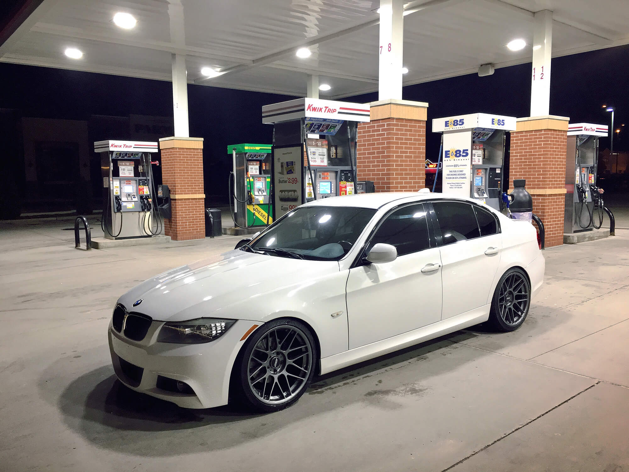 White 2010 BMW 328i (M-Sport) filling up at the gas station