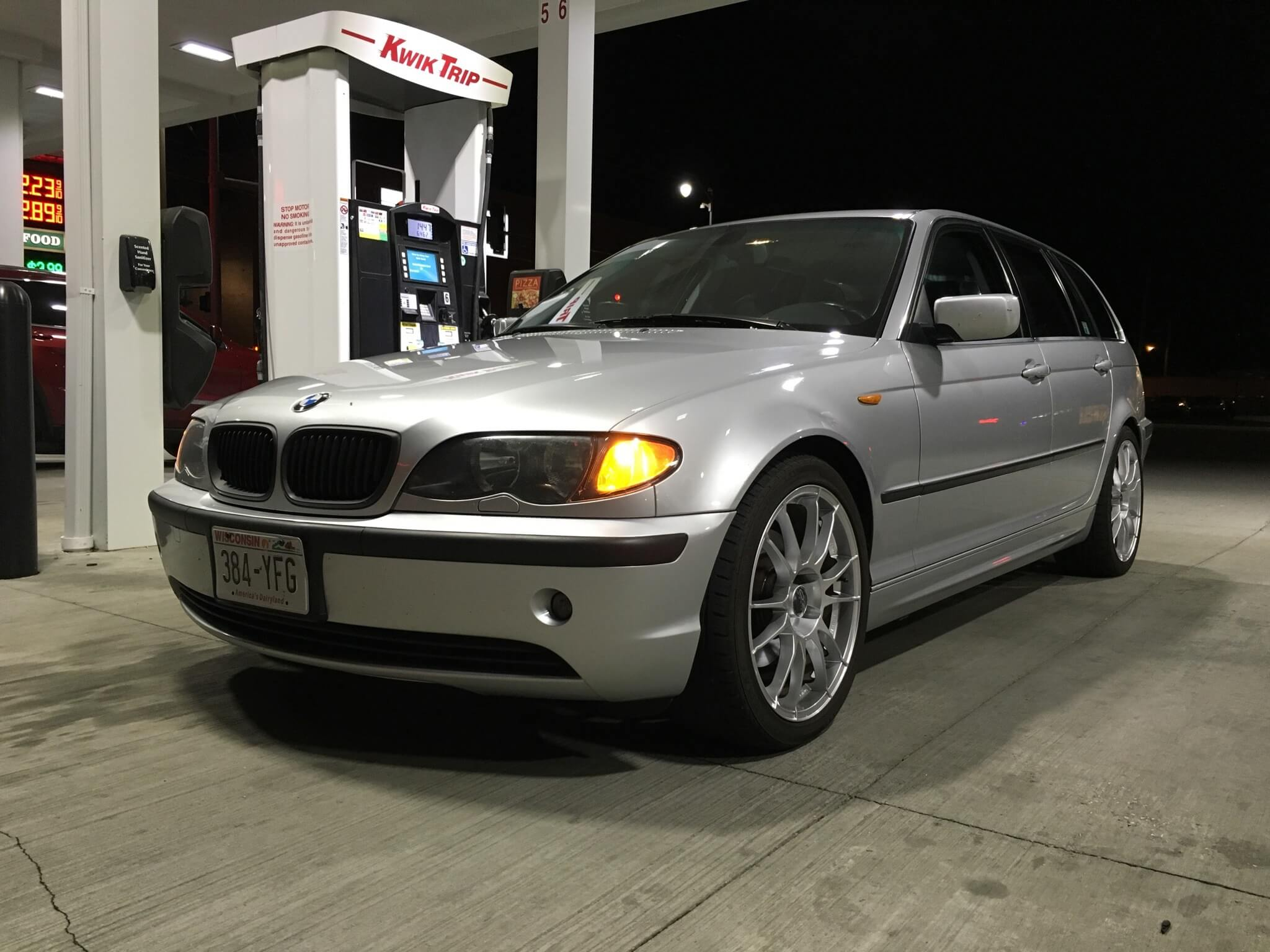 a silver 2005 BMW 325ixT filling up at the gas station