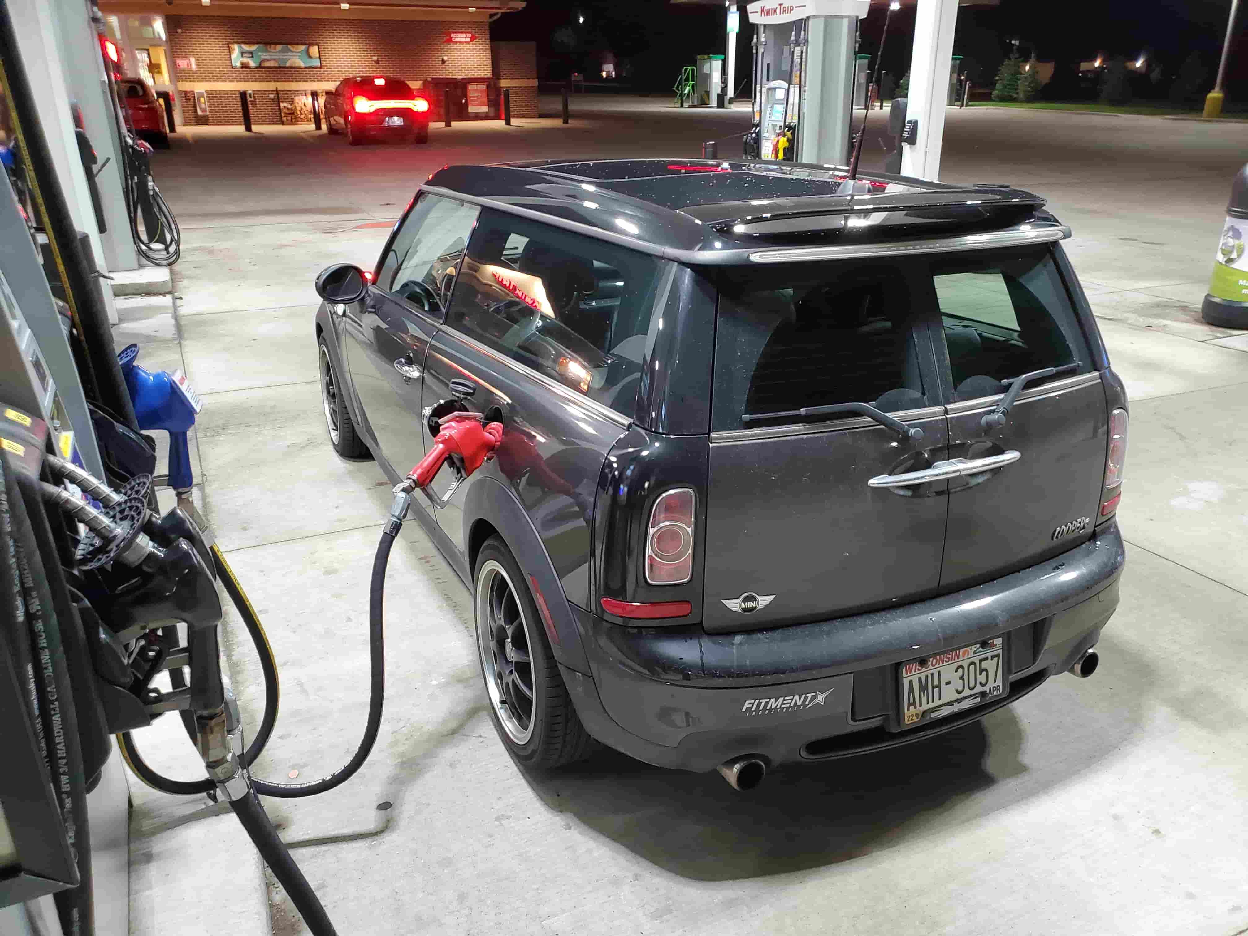 Mini cooper at the gas station filling up