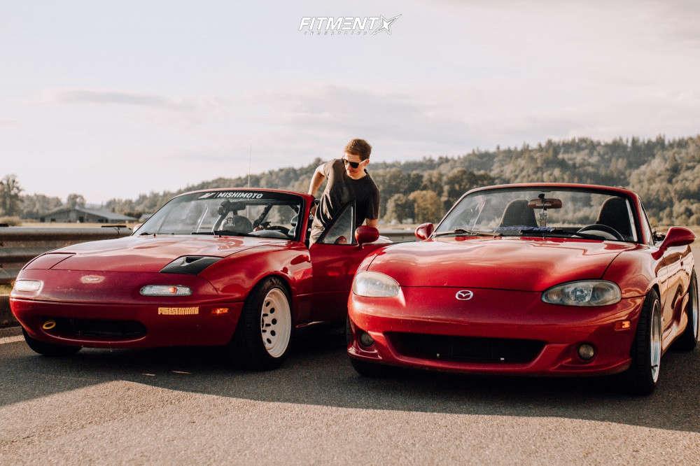 2004 Mazda Miata parked next to another Miata