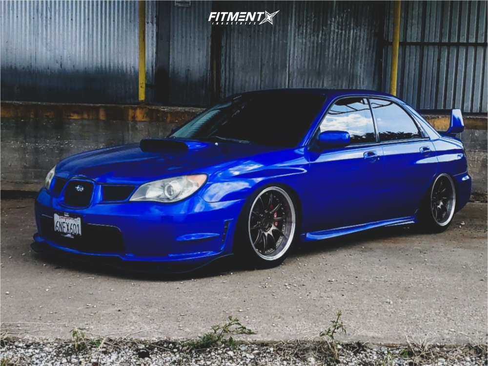 Blue 2006 Subaru WRX with Aodhan DS07 wheels, Federal SS595 tires, an Raceland air suspensiond