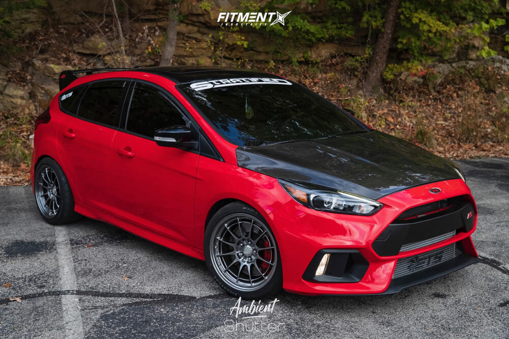 A red 2018 Ford Focus RS running Enkei NT03M wheels wrapped in Firestone Firehawk Indy 500 tires, and Whiteline lowering springs